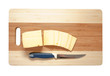 cheese on an wooden cutting board