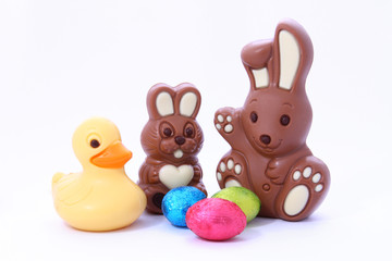 easter chocolate toys (rabbits, duck) and colorful easter eggs