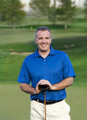 Smiling Mature Golfer on golf course