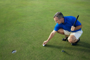 Active Male Golfer Putting