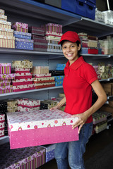 young woman working  in a gift box store