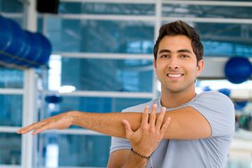 Man stretching his arm