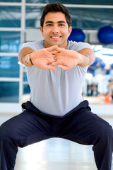 Man stretching at the gym