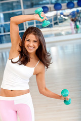 Gym woman with free-weights