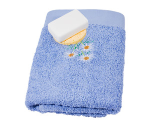 Soap and sponge on a towel