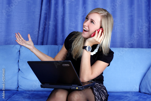 woman calling by phone and working with PS at home in sofa