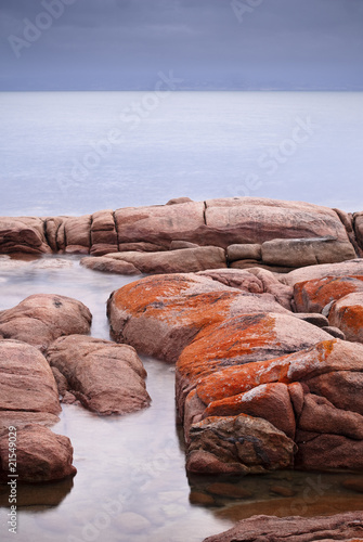 Orange lichen rocks at Freycinet National Park