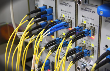 Optic cables connected to router ports
