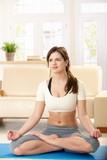 Girl in lotus posture poster