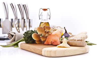 exotic mushrooms on a wooden cutting board