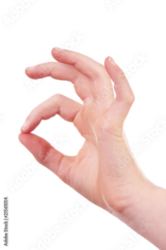 kids hand is making OK sign over white background