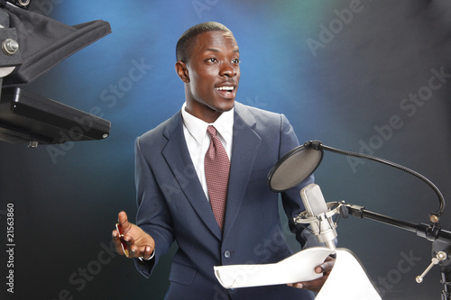TV/Radio news anchor with prompter and microphone