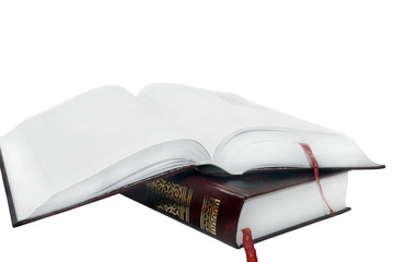 open book lying on another book isolated on a white background