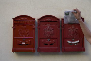 3 mailboxes with hand