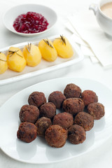 Swedish Kottbullar meatball with brunas sauce, boiled potatoes