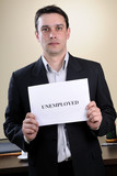 upset man showing unemployed message poster