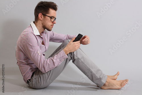 a young man with a phone