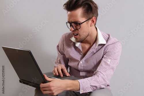 a young man with a laptop