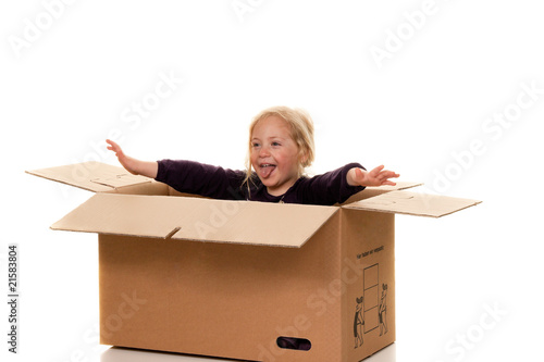 Child in cardboard box. Located on moving to a box.