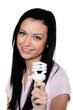 Women with energy-saving lamp. Energy saving lamp for