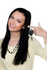 Woman with car keys to driving test