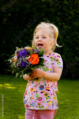 Child with flowers. Gift for Mothers Day
