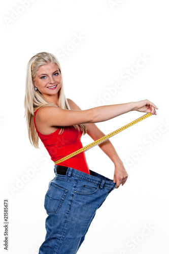 Woman after a successful diet with large trousers
