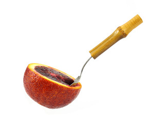 Blood orange with fruit spoon