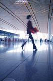 Woman hurrying in airport. poster