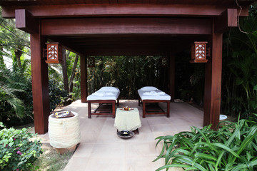 Massage tables in tropical garden