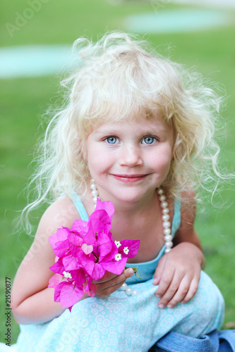 Portrait of a beautiful little girl with white curly hair