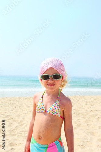 Portrait of funny little girl on sea