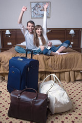 Happy young couple in hotel