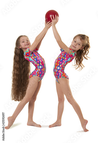 Two little girls gymnasts with the ball