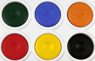 close up of a children's watercolour paint palette