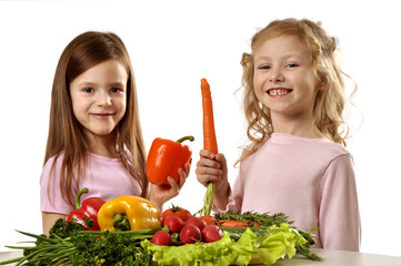 Little girls with bunch of vegetables