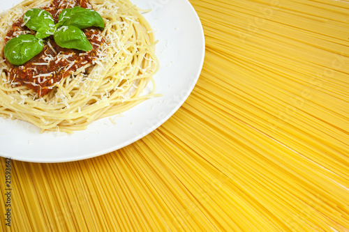 Plate of Spaghetti Bolognese on A Sunny Display of Dried Pasta
