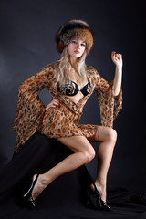 fashion young woman in dress with leopard style anf fur winter h