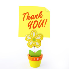 Flower note holder with yellow stick note saying thank you