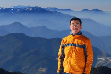 asian mountaineer with beautiful mountain scenery.