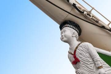 Boy figurehead on sailing ship