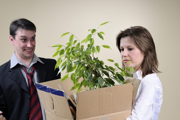 depressive woman leaving office and her cheerful partner