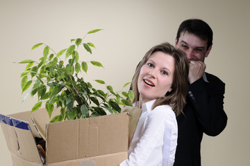 satisfied boss and fired woman leaving office