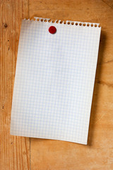 blank note on a wooden board