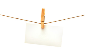 White card with clothes peg isolated. Series