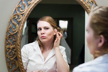 Bride Puckering Lips at Mirror