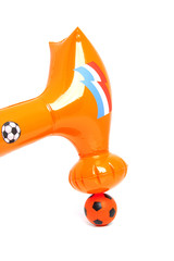 hammer over orange soccer ball over white background