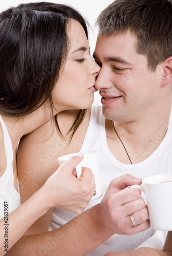 Young couple having breakfast in bed.