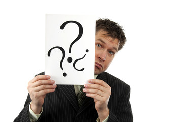 Businessman is holding question marks over white background