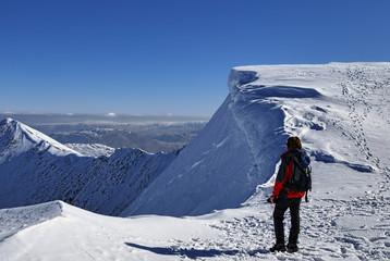 Mountaineer on snowy summit